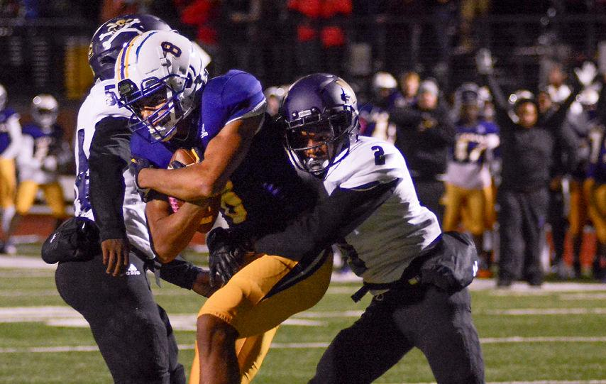 Hickman's wide receiver TJ Turner secures the ball