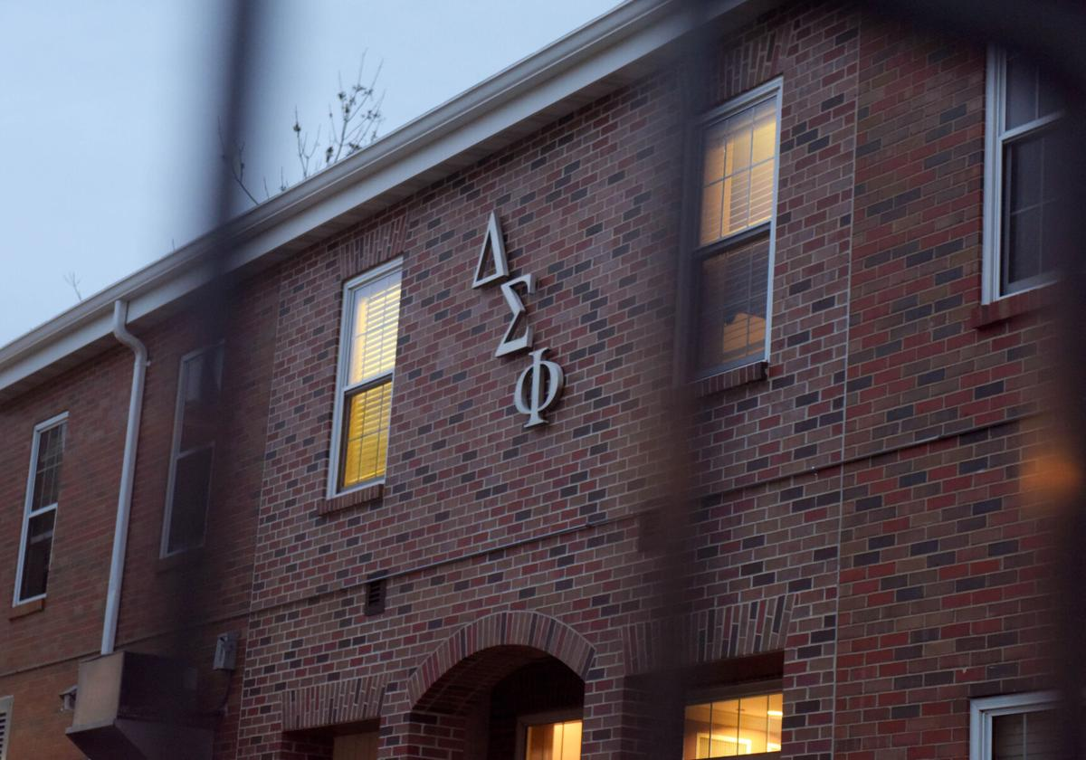 House lights remain lit as Delta Sigma Phi members move out of their house