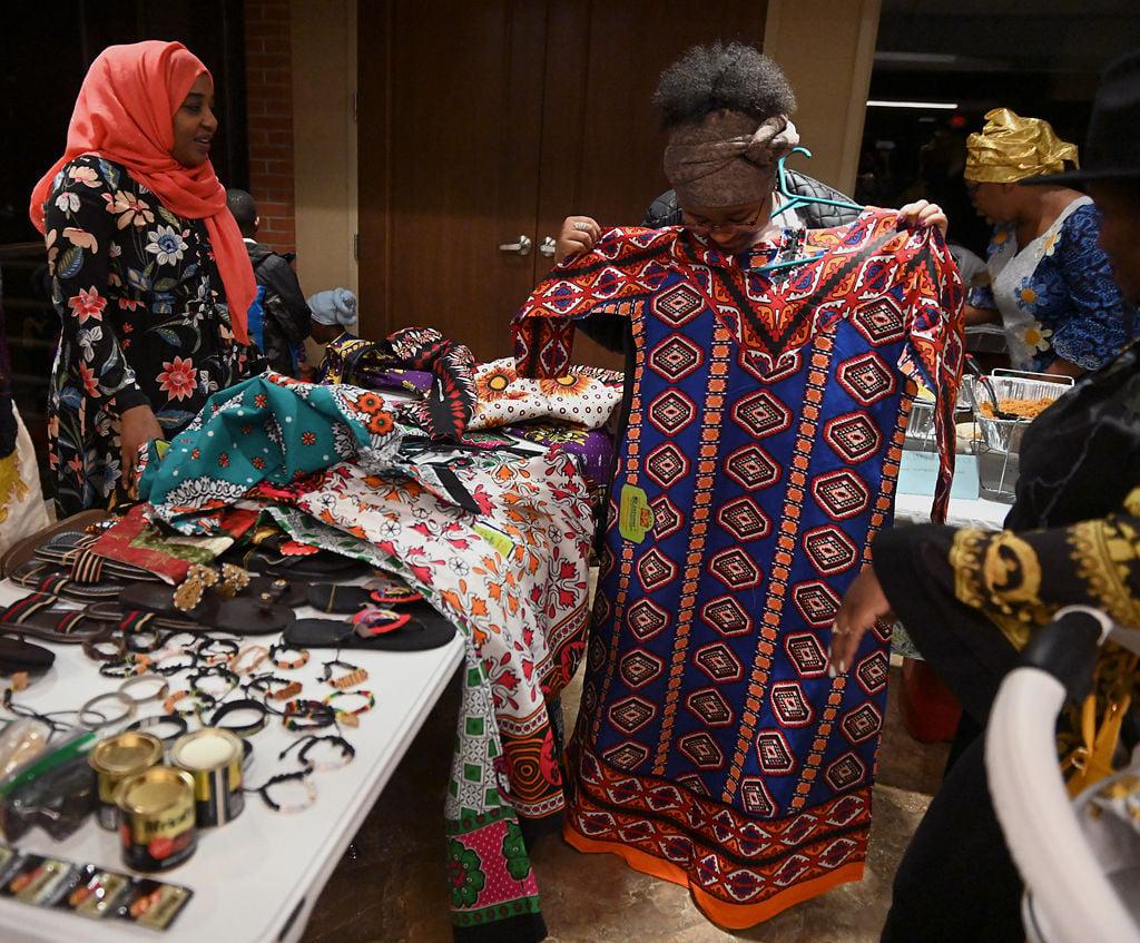 Zayana Hamid, left, helps Caroline Wanjiru choose a dress