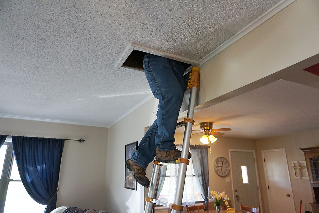 Joe Pangborn goes up his ladder