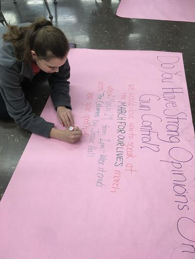Savannah Wittman, a junior at Rock Bridge High School, makes a banner
