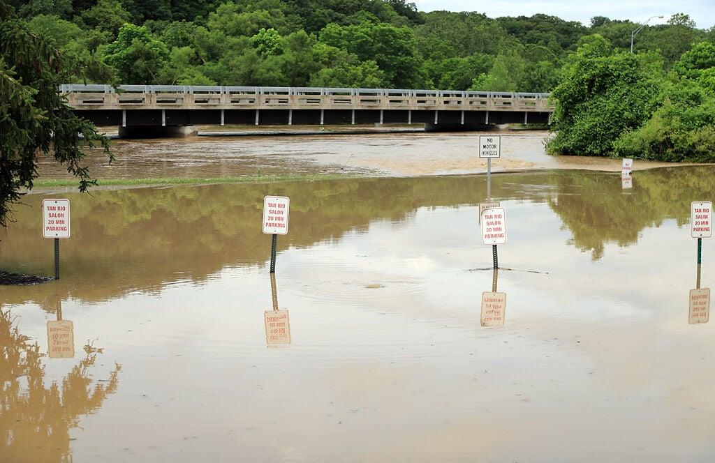Hinkson Creek floods Wilson's Fitness parking lot.