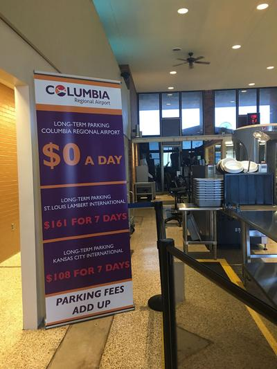 A sign advertises Columbia airport's free parking