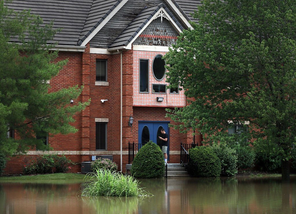 Floodwaters reach the steps of an office building on Forum Boulevard