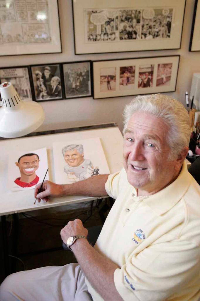 Murray Olderman drawing at his desk