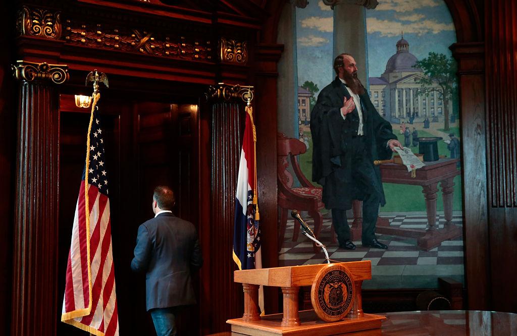 Missouri Gov. Eric Greitens leaves the podium after announcing his resignation
