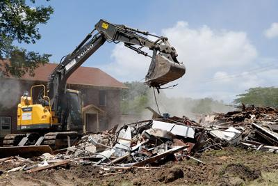 Crews work to remove rubble after Victorian-style house demolished