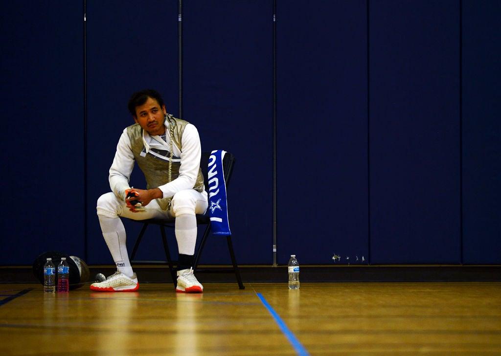 Aprizal Storkson waits between matches