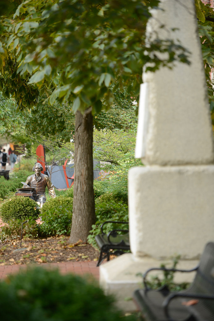 A replica of Thomas Jefferson's epitaph and obelisk tombstone sits on the Francis Quadrangle