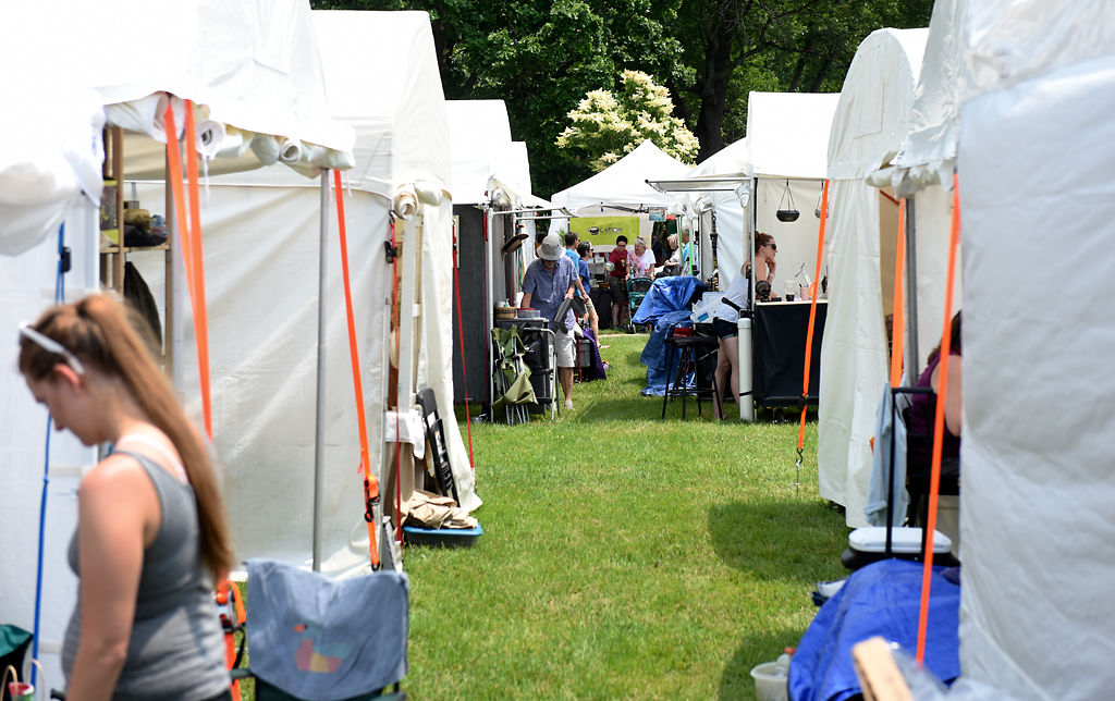Vendors tend to their stalls at Art In the Park