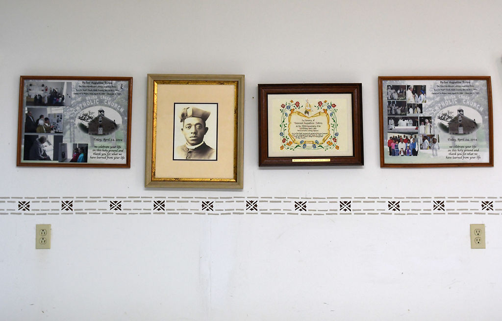 Memorabilia of Fr. Augustus Tolton hangs on the wall
