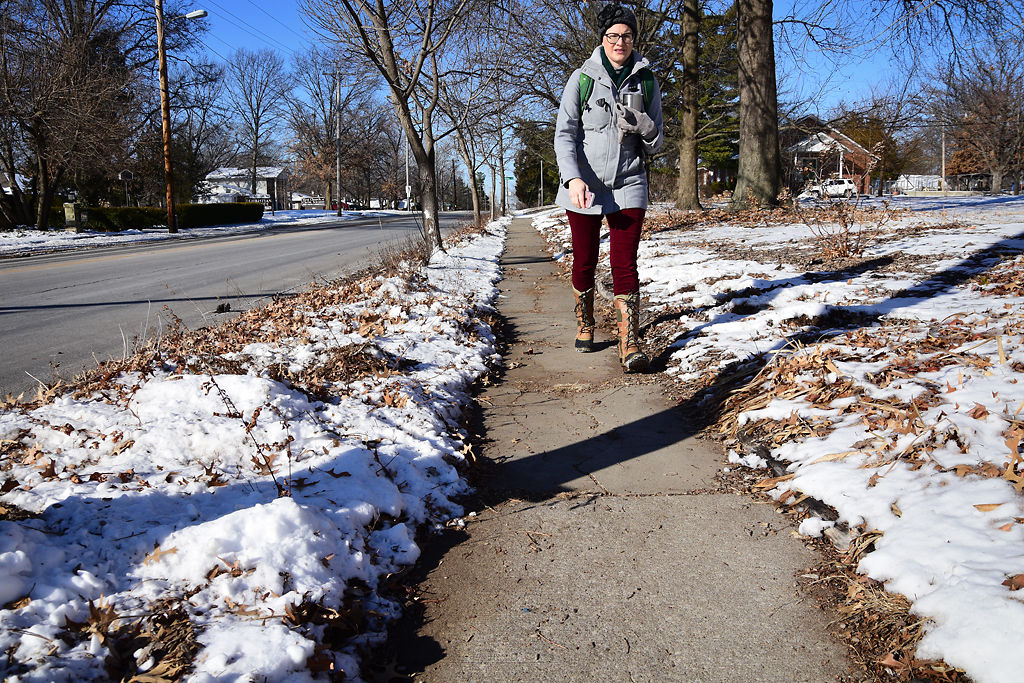Columbia resident Rebecca Bruton walks along the sidewalk