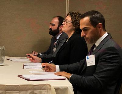 Judicial Circuit Court judge Joseph Goff Jr., CLE attorney Garnett Matthews-Campbell and trial lawyer Sanders Sowers provide feedback to teams in the Missouri Bar's Show Me Constitution on Thursday