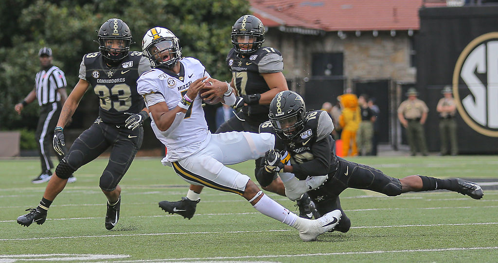 Missouri quarterback Kelly Bryant is driven to the ground