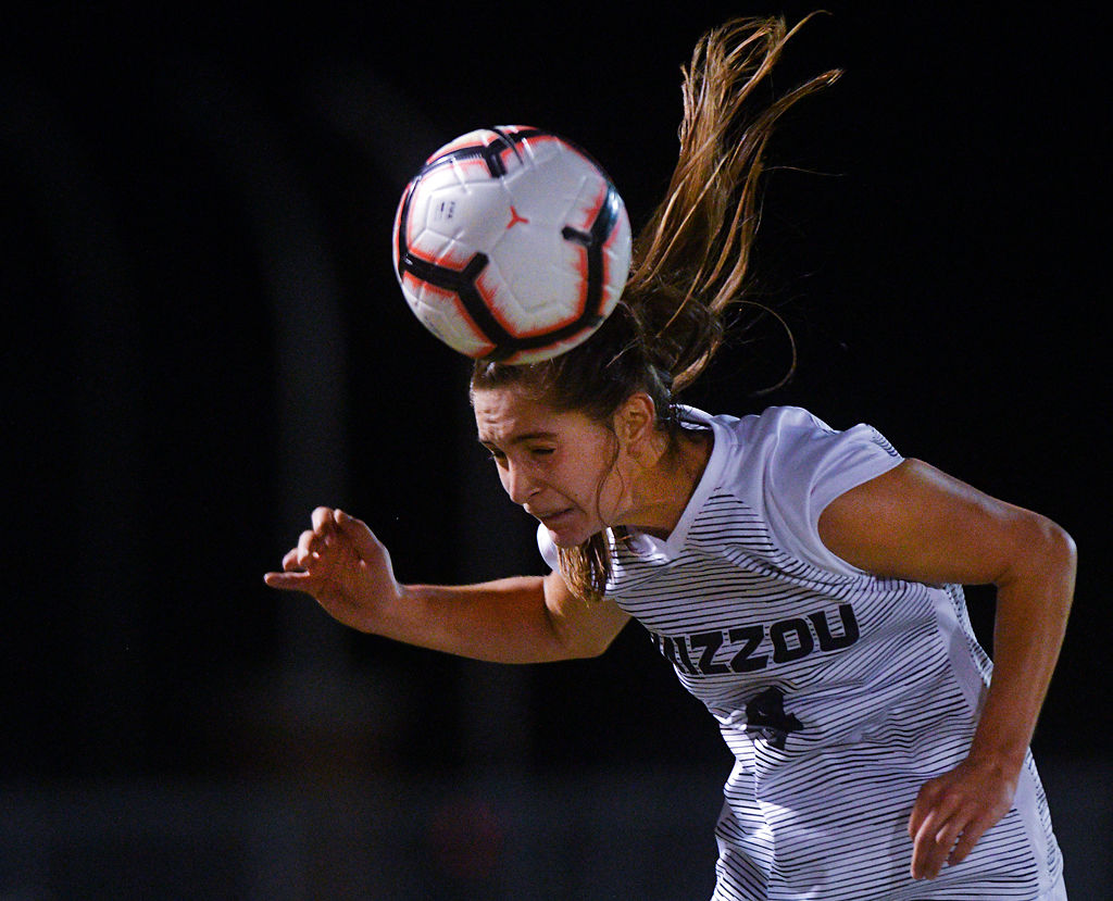 Missouri junior Bella Alessi heads the ball