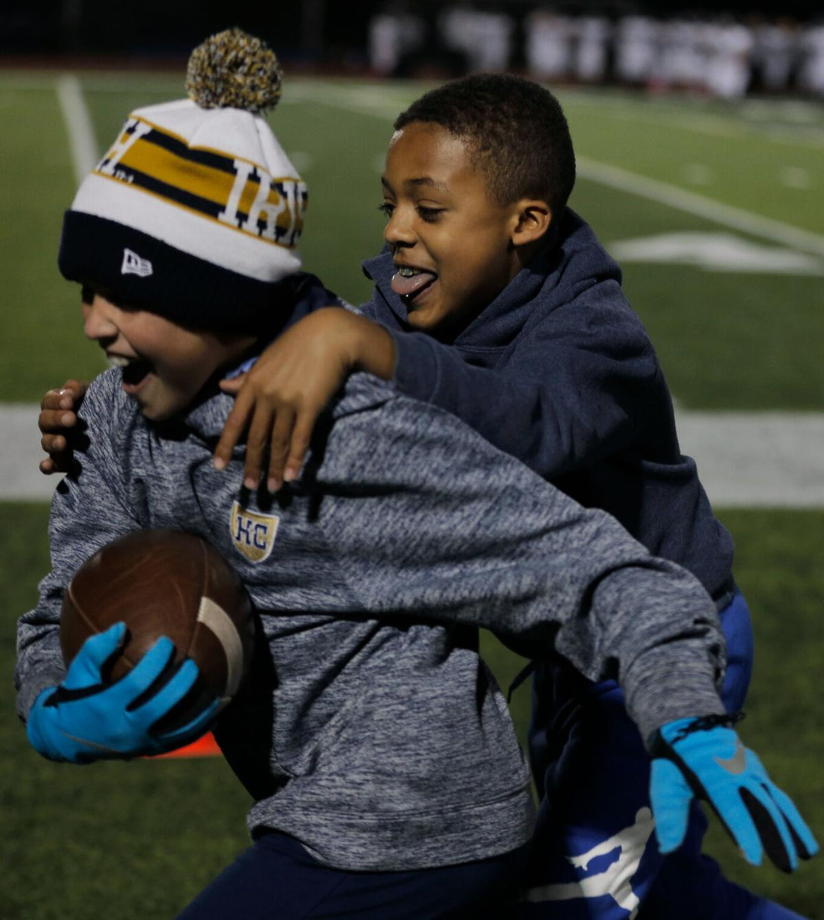 Brenden Ralston, 9, and Keegan Bell, 10, play their own game of football