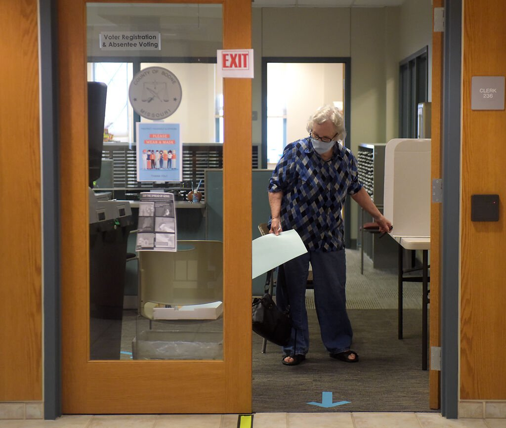 Nancy Robinson carries her ballot to be processed on Wednesday at the Boone County Clerk's Office.