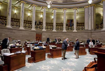 Senators gather after a recess to debate an amendment to Kehoe's ethics bill