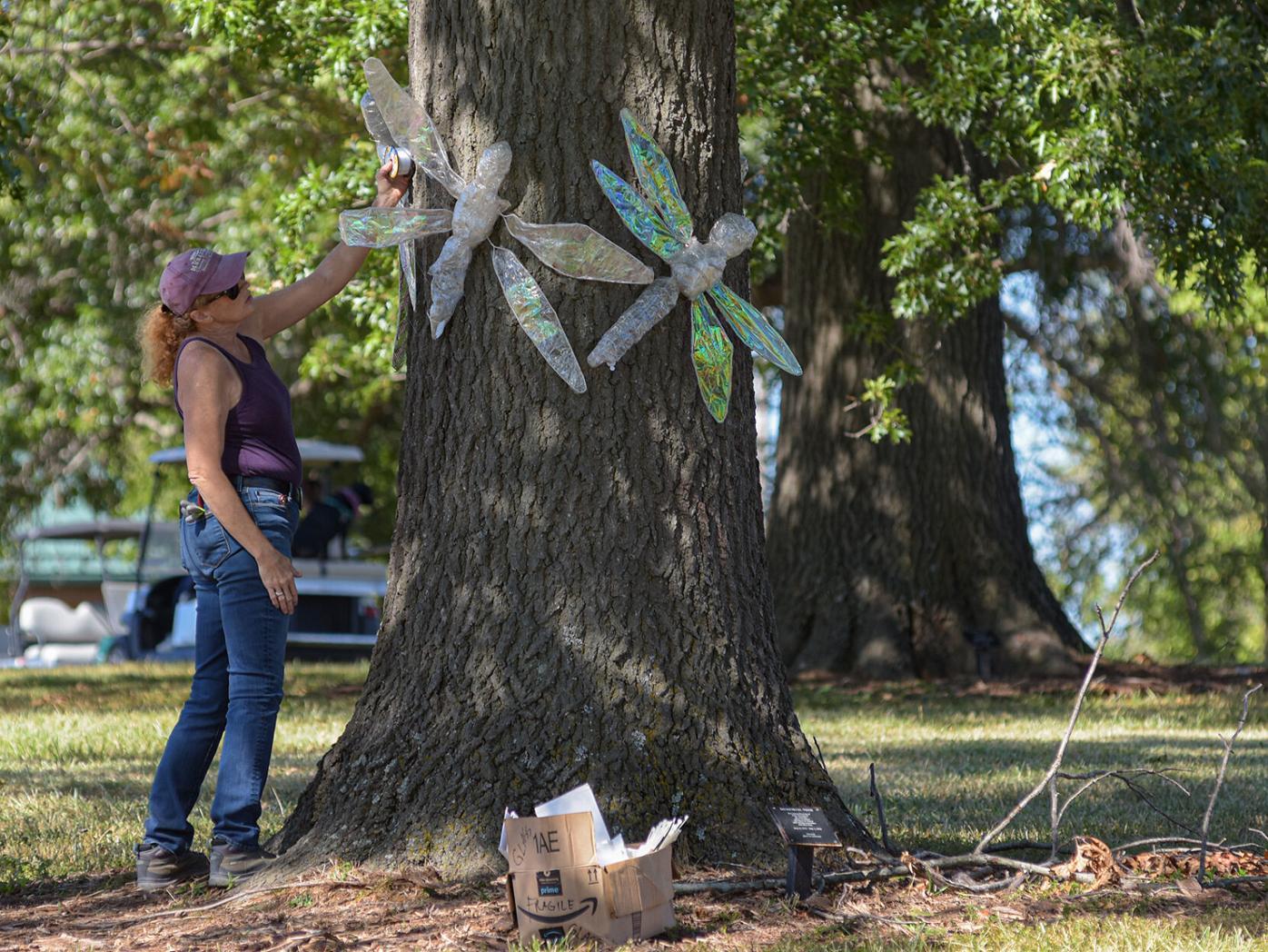 Martha Daniels decorates a tree