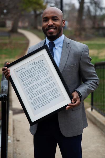 Columbia Public School Board candidate David Seamon poses for a portrait in Peace Park.