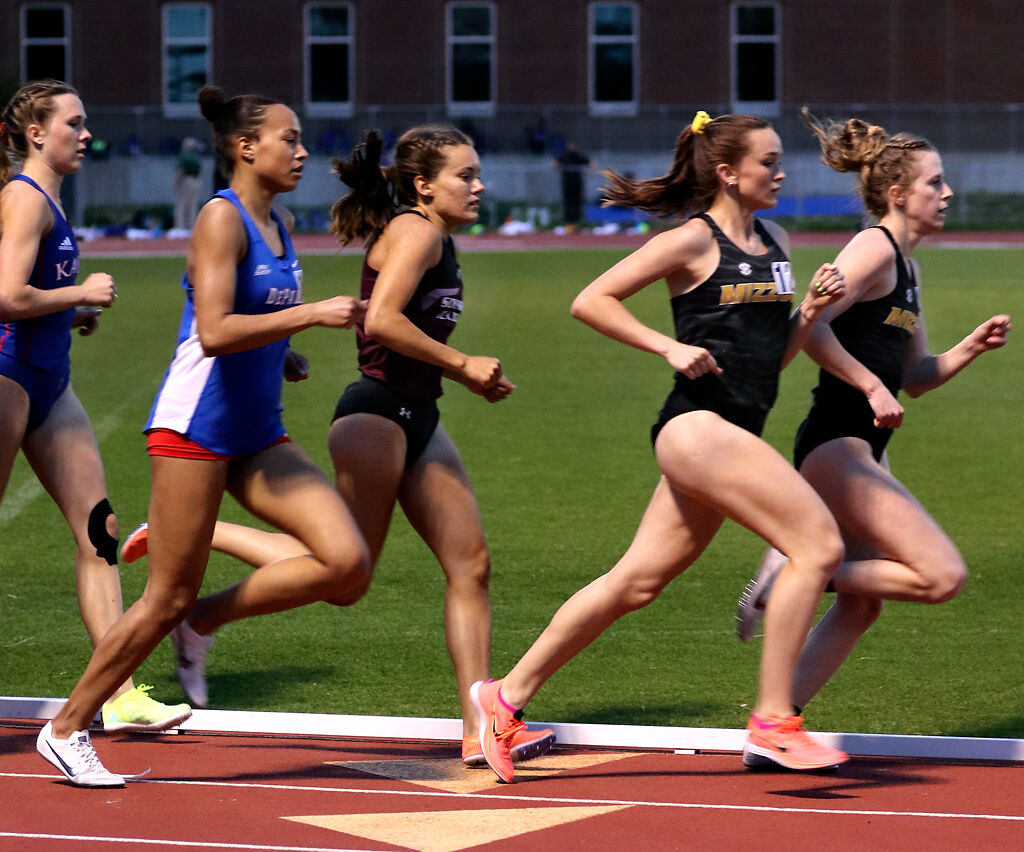 Racers compete during the 1500-meter run