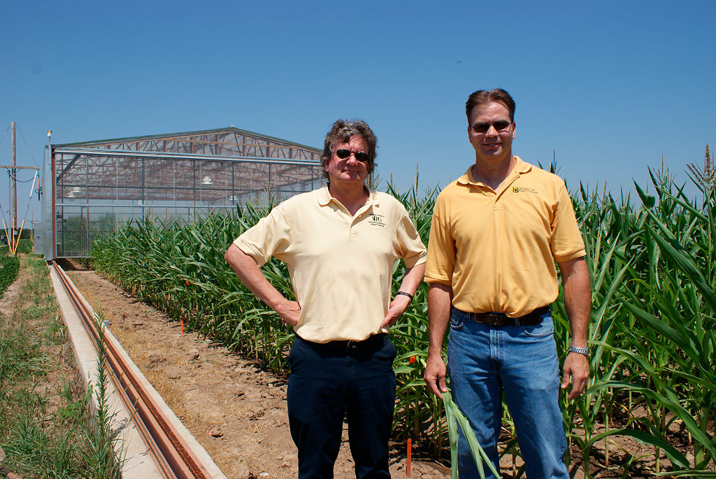 Bob Sharp and Felix Fritschi stand in front of a rainout shelter at Bradford Research Center