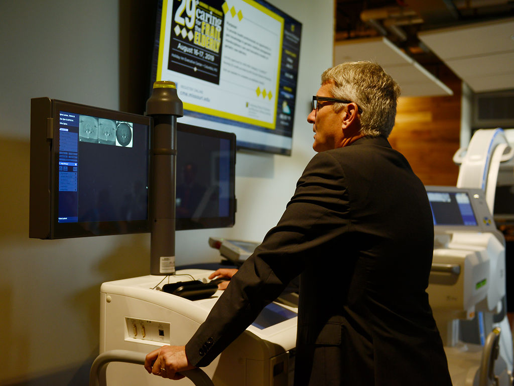 Herbert Westin, reads MRI results during a demonstration at the Alliance for Precision Health event