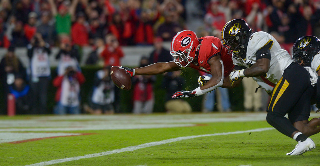 Georgia running back Divaad Wilson dives to cross the pylon for a touchdown