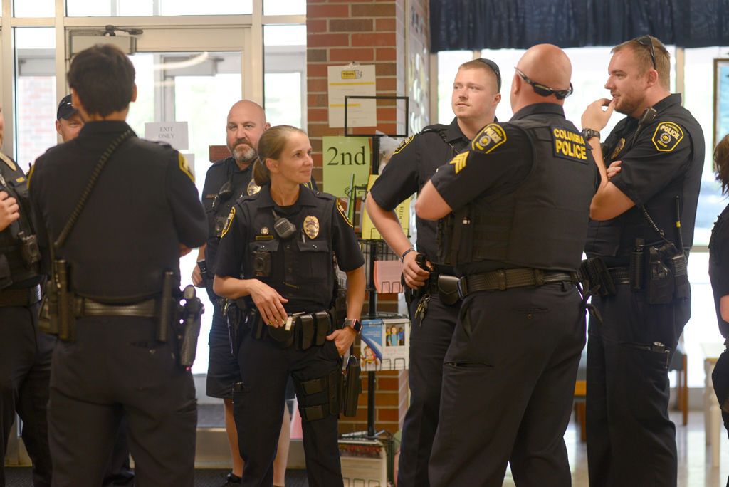 Columbia police officers gather at elementary school