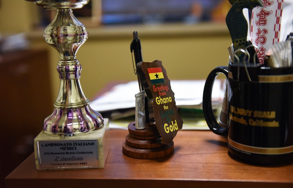Gifts from overseas patients are placed on Dr. John Jarstad's desk