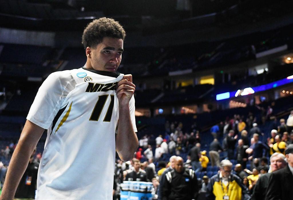 Jontay Porter walks off the court following Missouri's loss to Florida State
