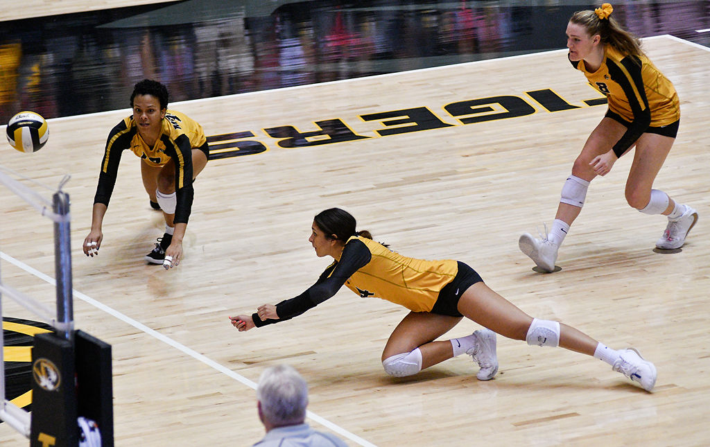 From left, Dariana Hollingsworth-Santana, Leandra Mangual-Duran and Claudia Dillon of Missouri attempt to make saves against Ole Miss