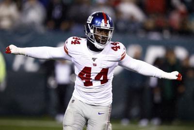 Giants re-sign leading sacker Markus Golden