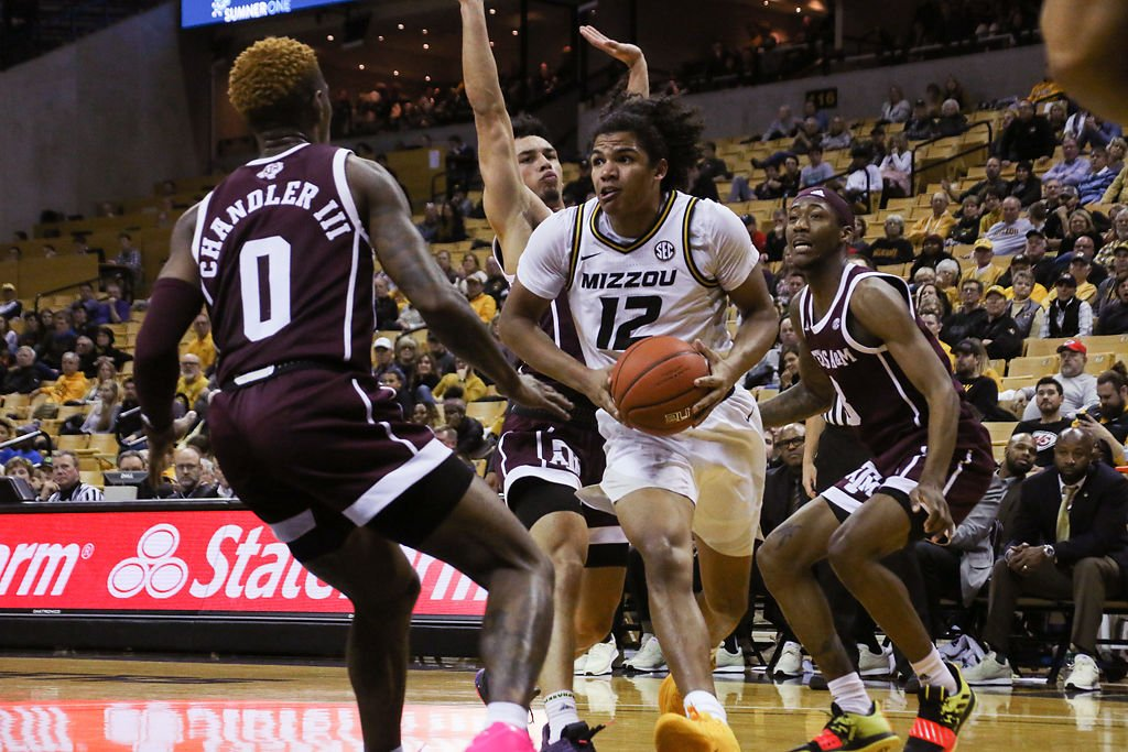 Missouri guard Dru Smith tries to get past Texas A&M guard Jay Jay Chandler