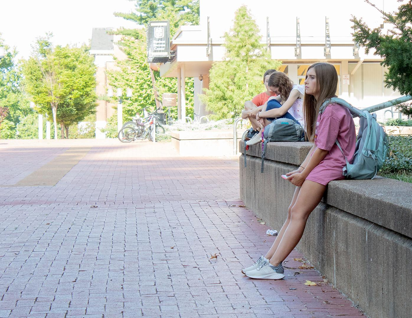 Alyson Craft sits on Lowry Mall