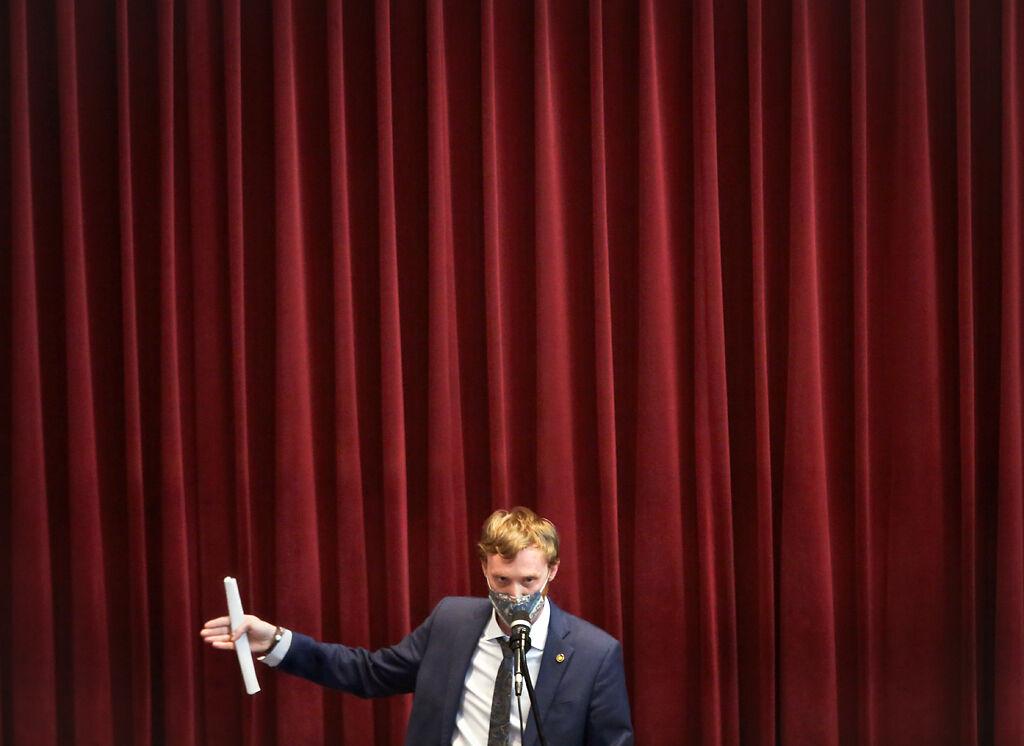 Representative Peter Merideth, D-St. Louis, participates in the floor debate