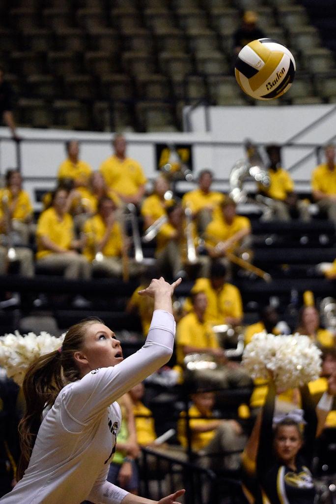 Melanie Crow tosses the ball for a jump serve (copy)