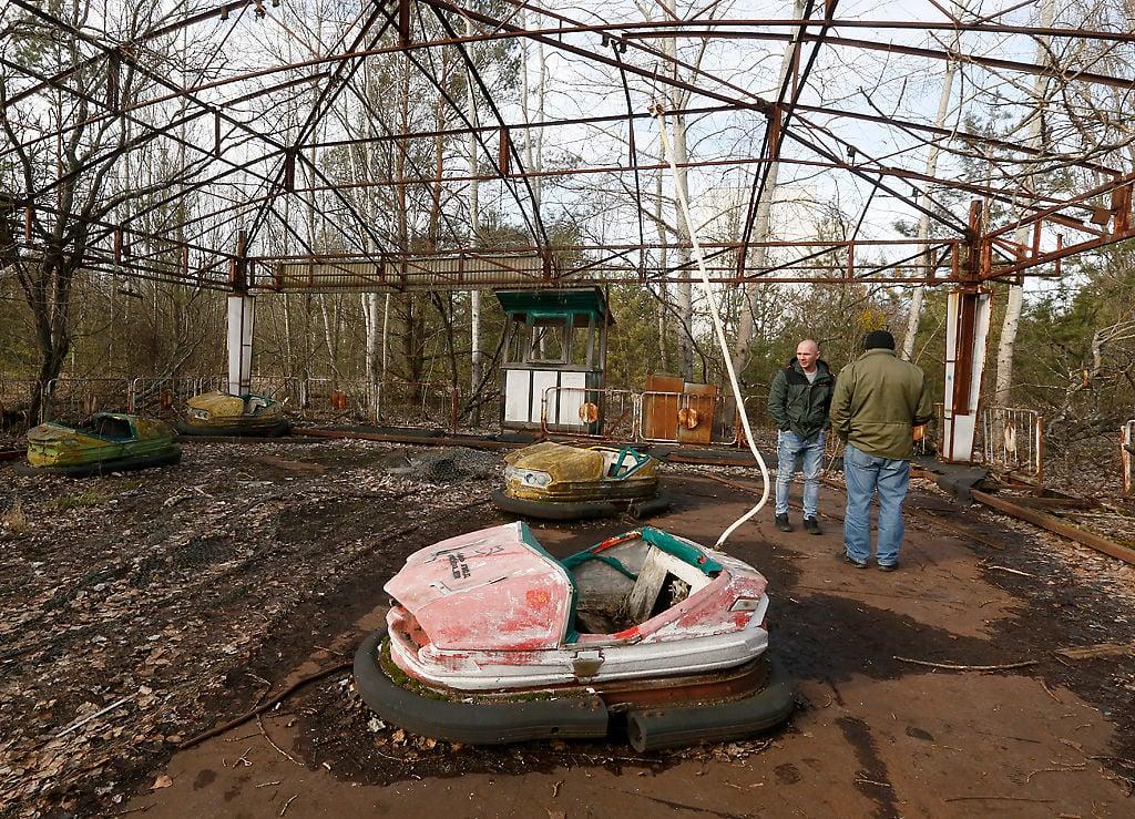 People visit an abandoned amusement park