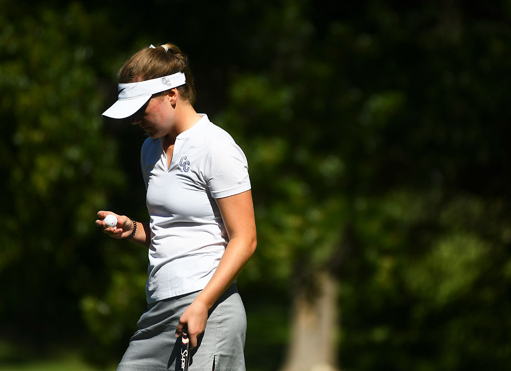 Columbia College golfer Emily Strunck waits for her turn to swing