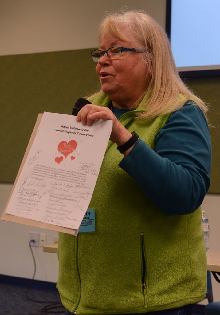 Meredith Donaldson, membership chair for the League of Woman Voters, invites community members to sign a Valentine letter