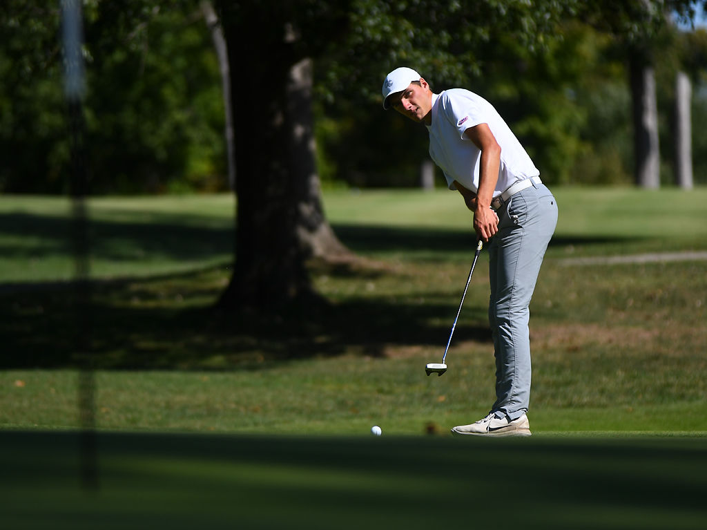Columbia College golfer Jesper Holke-Farnam putts the ball