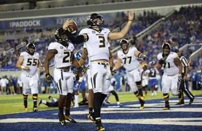 Missouri quarterback Drew Lock celebrates a touchdown (copy) 08cddc70a