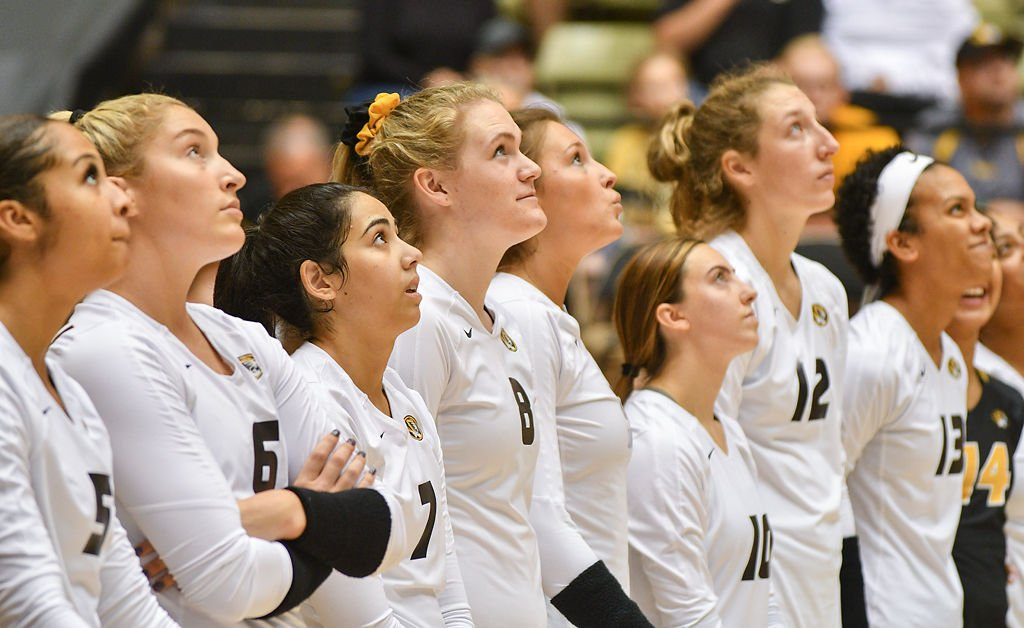 Missouri volleyball players look up at the scoreboard