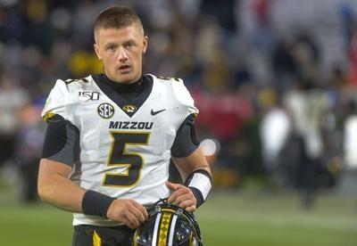 Missouri quarterback Taylor Powell walks off the field (copy)