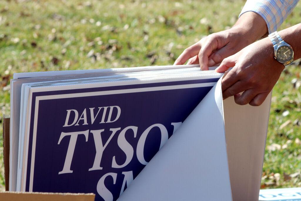 David Tyson Smith looks through signs
