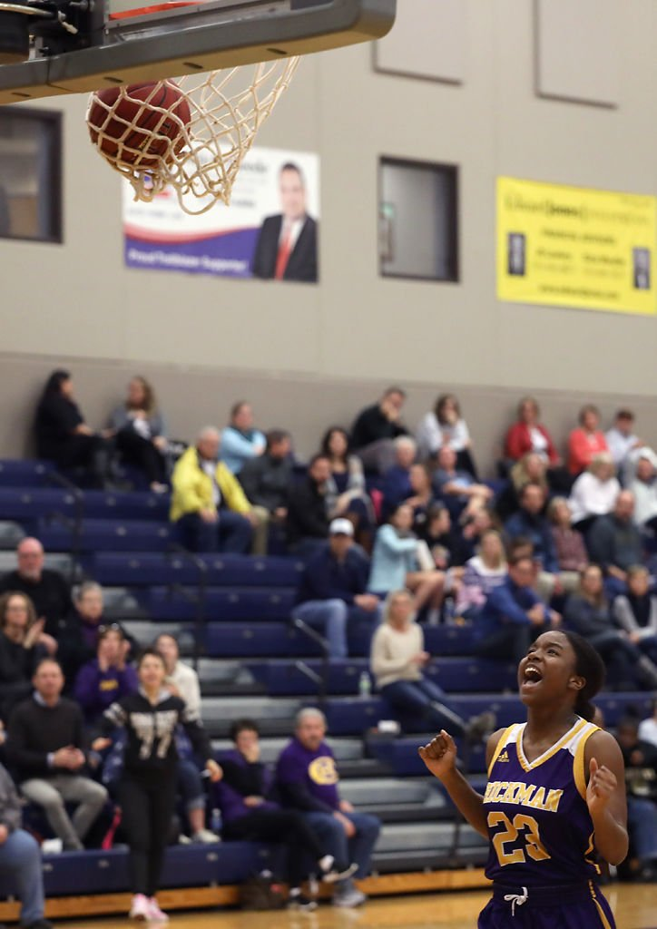 Kendra Boone celebrates after she makes a basket