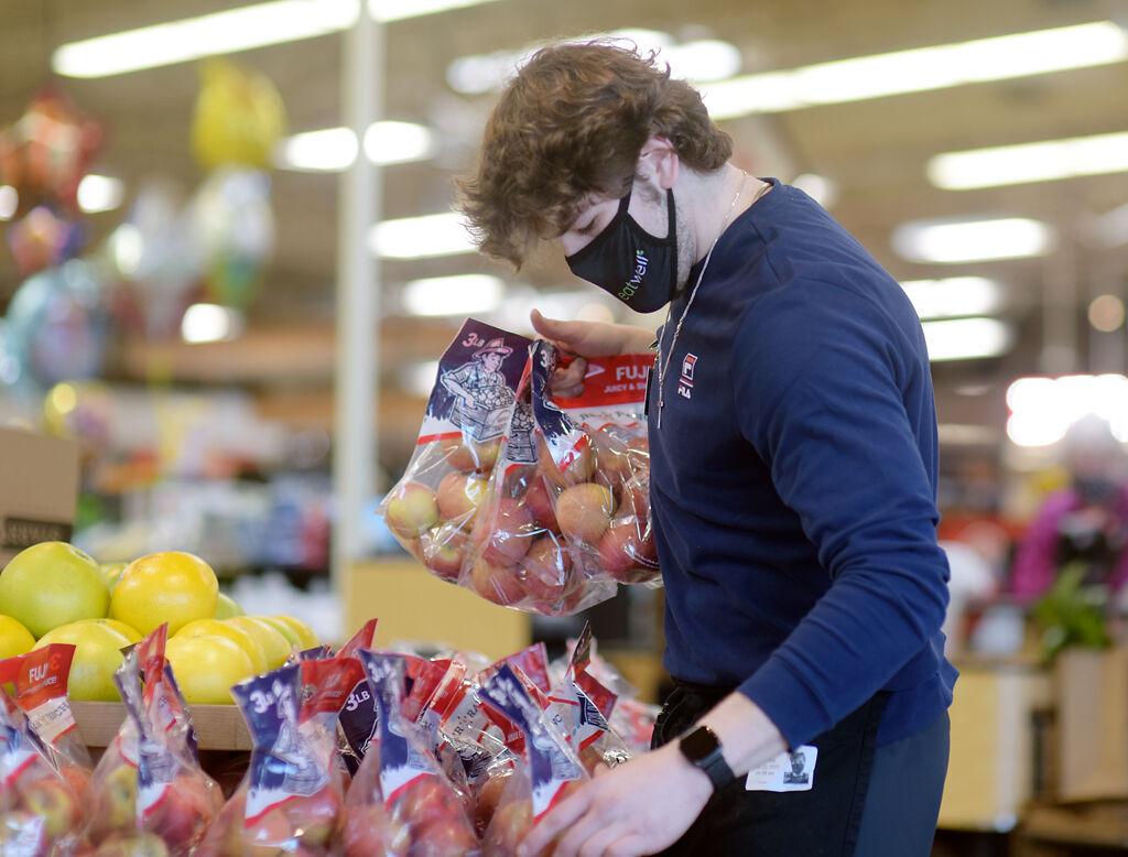 Jason Jacob displays Fuji red apples
