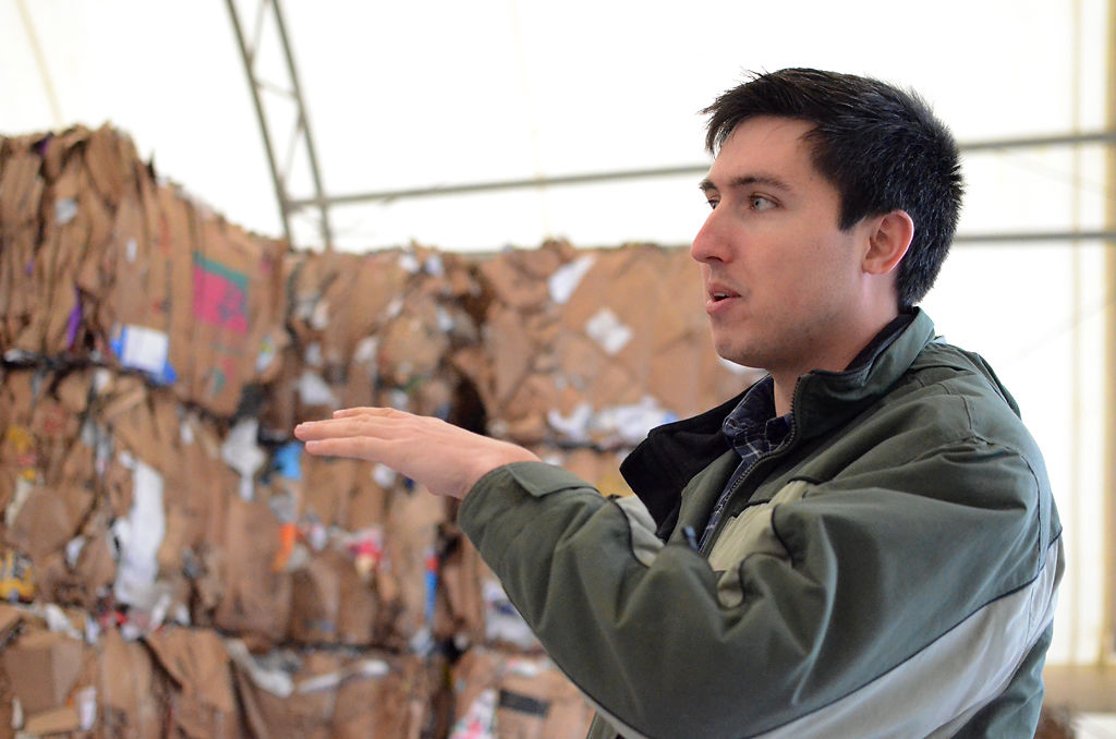 Ben Kreitner shows where the city keeps its different recycling materials