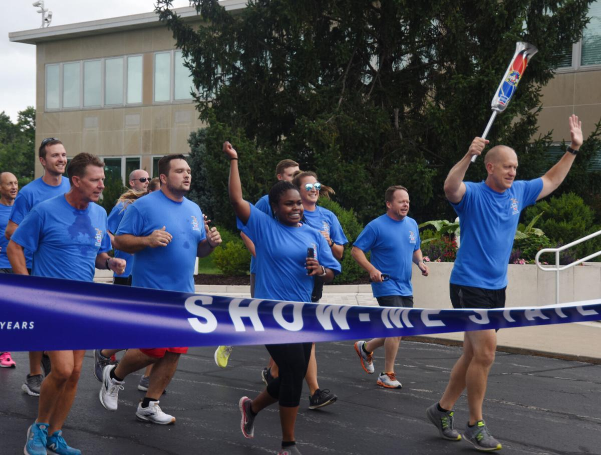 Show-Me State Games athletes run through the finish line