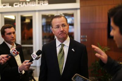 Columbia Mayor Brian Treece answers questions after a press conference from reporters
